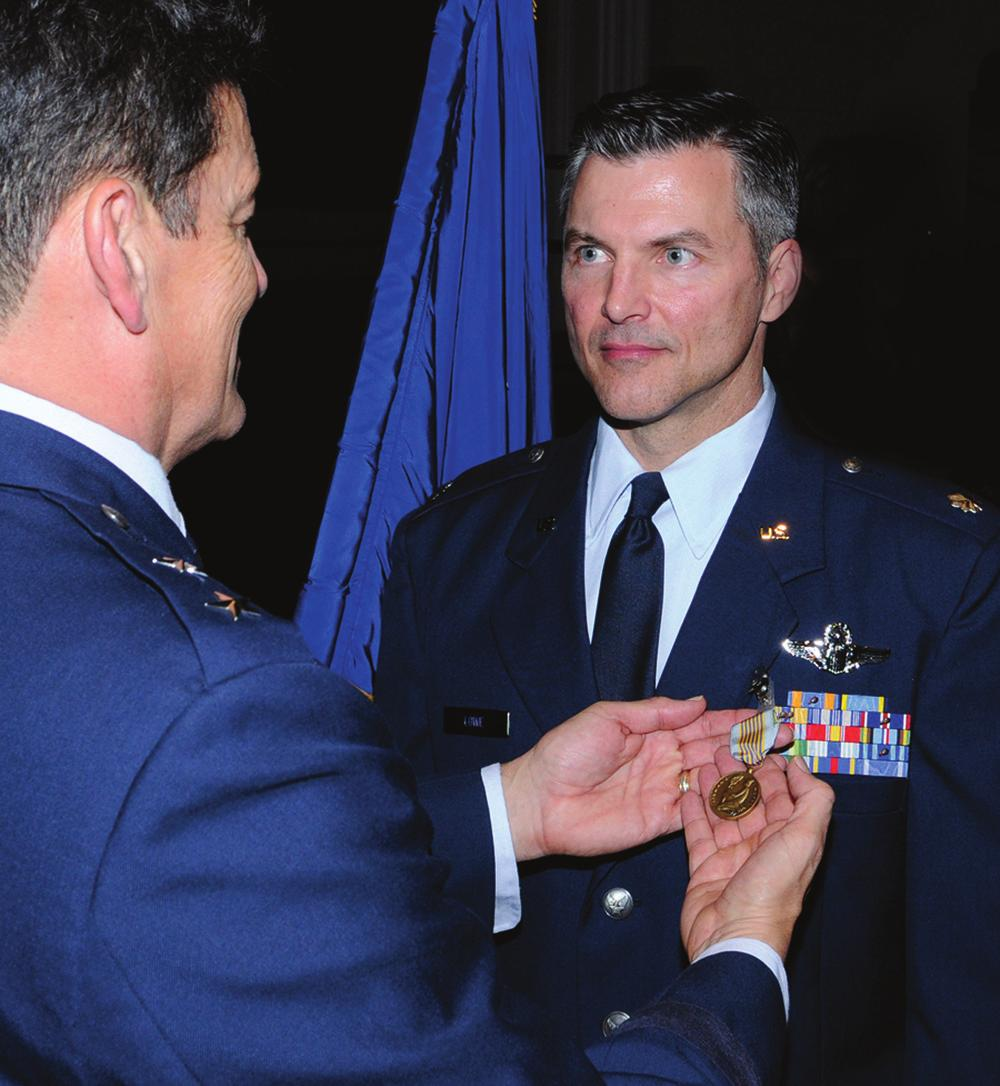 Texas, presents the Airman s Medal to Lt Col Richard