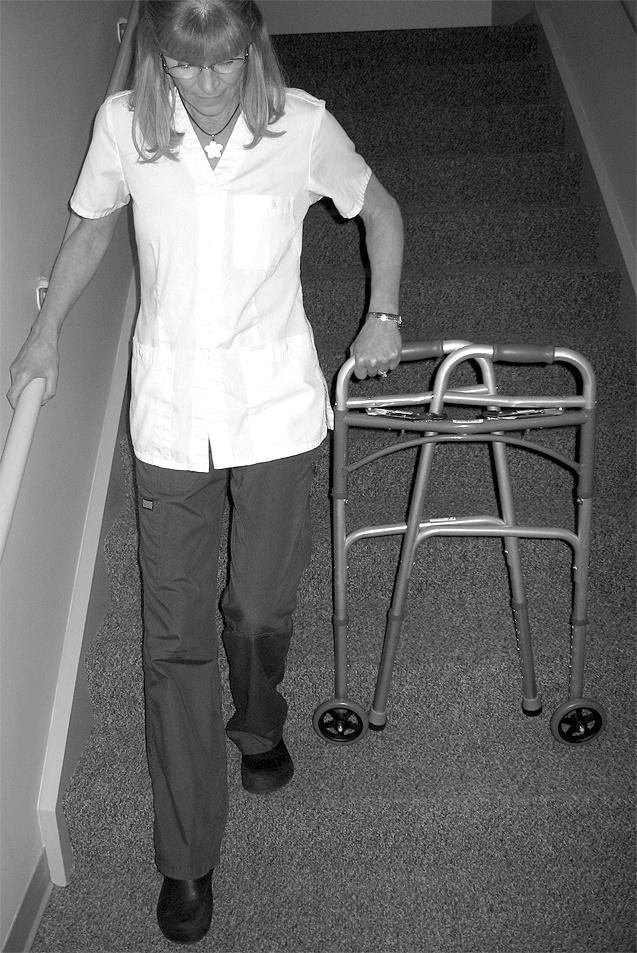 Alternate technique with a folding walker: Going Up Stairs: Fold your walker and place it sideways on the step in front of you using one hand.