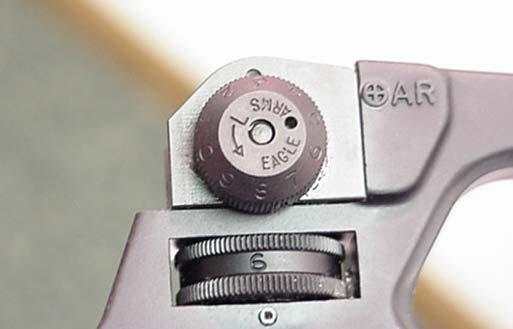 20 marked match rifle scale) or set the elevation knob to the distance to be fired, i.e. 2 for 200 yards. 2. Carefully aim and fire at the center of the target.