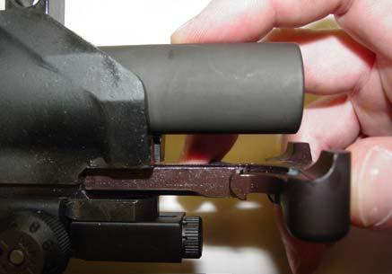 Pull the charging handle back and down to remove