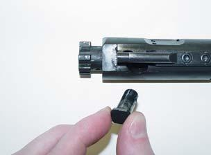 5. Insert the cam pin (You don t need to rotate it as you would in an M16.) 6. Drop the firing pin into its opening.