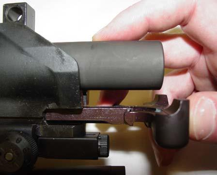 Slide the bolt carrier assembly, bolt extended, into the