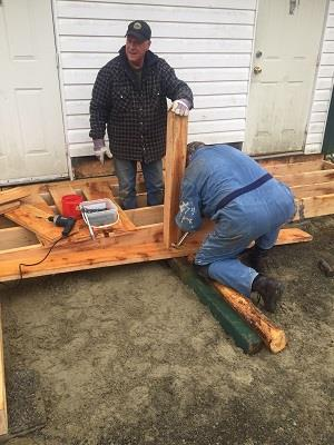 Photo 3 Preparing the lumber as John operated the bobcat to haul the lumber from the