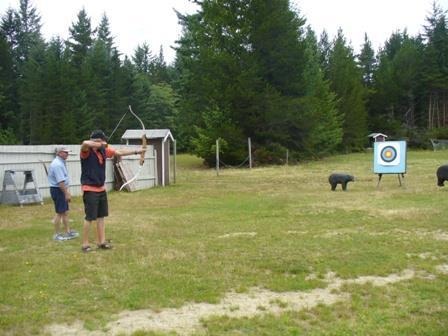 Right: Barry Kallies testing his archery skills.