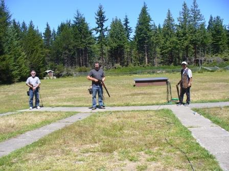 Centre: Father-son trapshooters, Ed and Mark