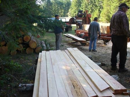 Left: Stacking the lumber as it comes off the sawmilling machine Centre: Lumber is stacked