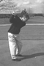 From the rear view, the club should be parallel to the target line with both hands under the shaft for support.