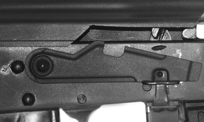 Flash hider 11. Barrel 12. Lower handguard 13. Magazine 14. Magazine release button 15. Trigger 16.