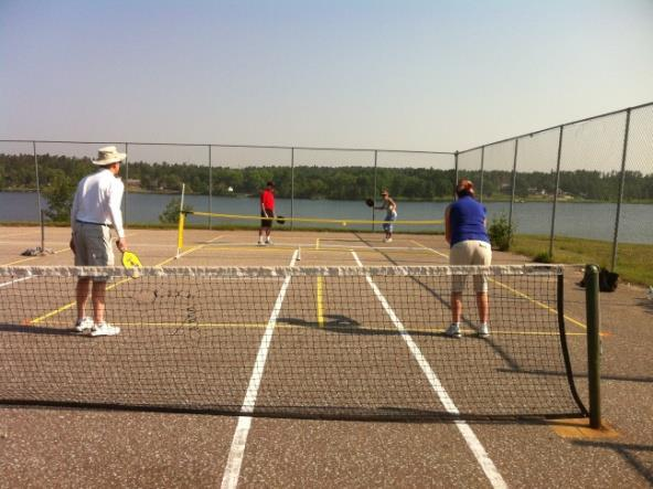 Garrow Park includes a swimming beach, docks, picnic benches, washrooms and tennis courts.