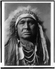 WHITE MAN RUNS HIM was a member of the Crow tribe sworn enemies of the Lakota. He served Col.