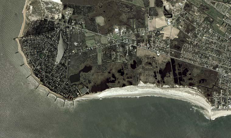 its shoreline. Erosion rates were measured around 6.1 m/yr just to the west of Cape May Inlet and between 5.2 to 6.1 m/yr in the vicinity of Cape May Meadows from 1927 to 1943 (U.S. Congress, 1953).