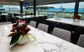 the MotoGP roof top Access to the Pit Roof Bar with views of Turn 12 Morning tea, buffet lunch and