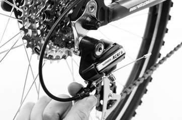 TUNING THE GEARS - REAR DÉRAILLEUR TUNING THE GEARS - REAR DÉRAILLEUR LIMIT SCREWS WARNING: YOUR GEARS ARE NOT TUNED. Tuning the gears correctly is very important.