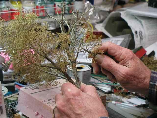 Once the parts are ready, you can begin attaching branches you may want to look at a real tree or a picture of one while you re doing this.