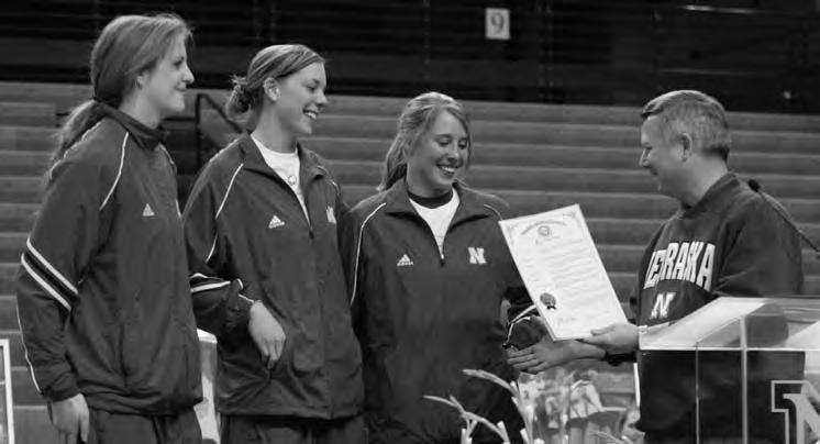 HISTORY Husker captains Tracy Stalls, Christina Houghtelling and Dani Busboom receive a proclamation from