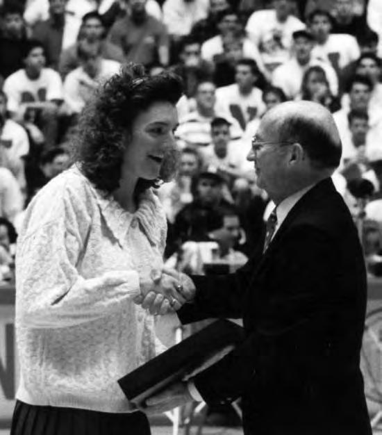 HISTORY Janet Kruse receives her NCAA Top Eight Award in 1992. Kruse is one of four Husker volleyball players who have been NCAA Top Eight Award winners.