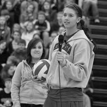 Middle: Lindsey Licht speaks to elementary school kids as