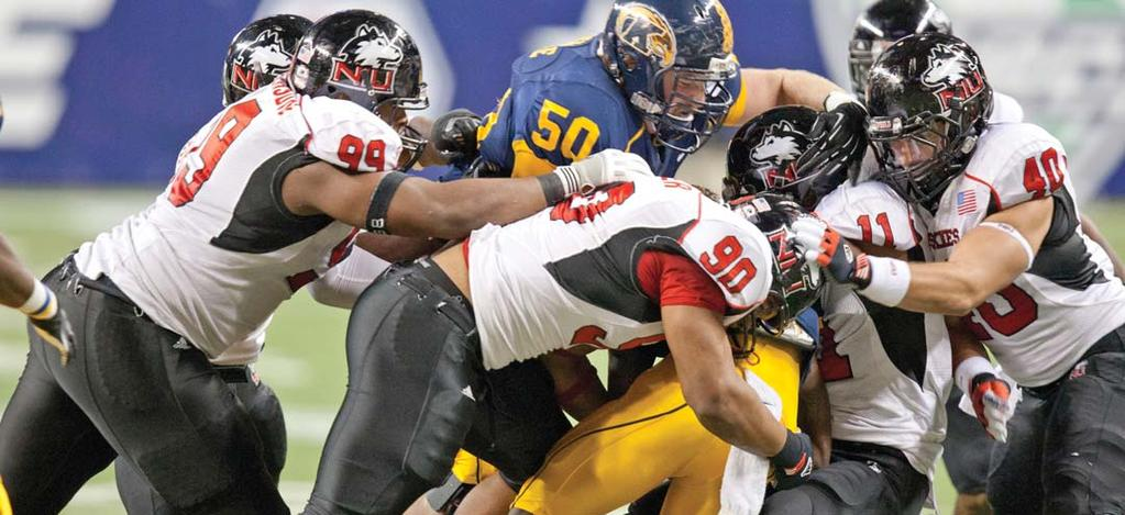NORTHERN ILLINOIS UNIVERSITY FOOTBALL HISTORY huskie all-americans Alan Baxter (90) and Nabal Jefferson (99), along with tight end Jason Schepler, were named Academic All-Americans by the College