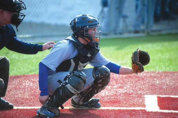 Catcher Eric Terry anticipates the pitch