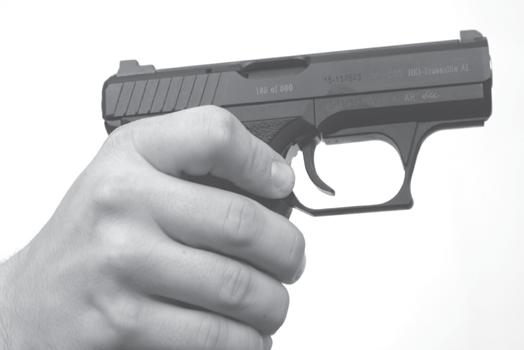 PRESS MAGAZINE CATCH DOWN t To lock the slide to the rear, press the slide catch lever rearward with either the forefinger or thumb of the shooting hand