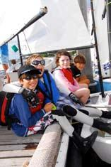 Laser Radial sailors to a lively regatta.
