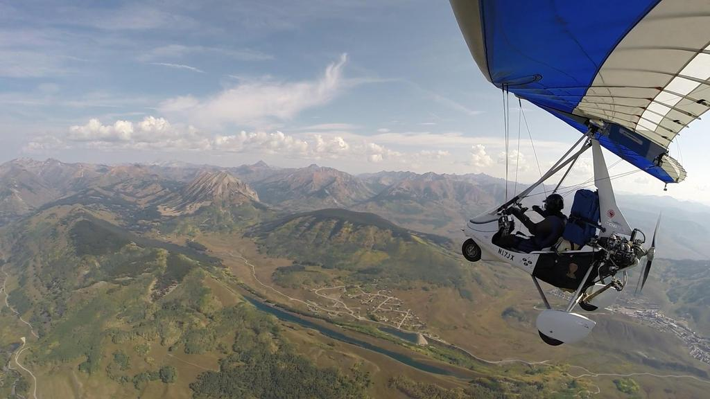 After crossing a couple ridges, the town of Crested Butte came into view. Here I am flying over Meridian Lake, long and narrow lake that lies in a grove carved by glaciers on top of a ridge.