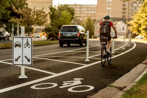 "Arlington County also uses green paint or markings at critical locations where bicycle lanes and drive lanes cross each other in unusual configurations, such as at ""Y"""