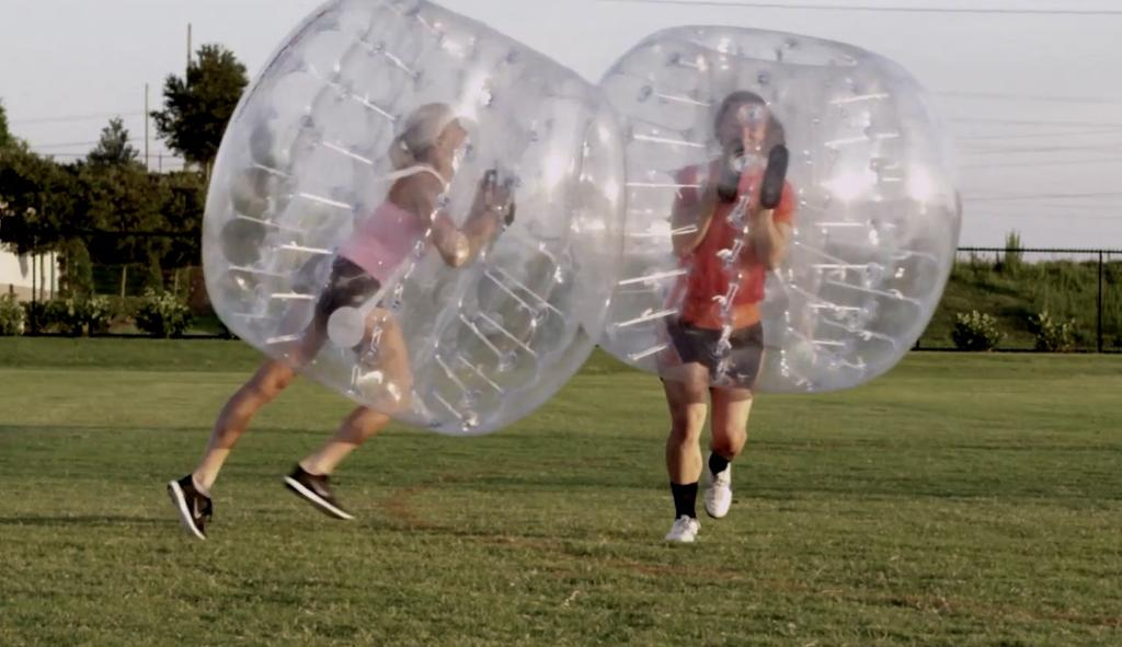 Eight (8) participants enter the inside of a giant, four-foot diameter clear ball and play.