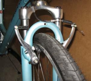 Spin so the brake cable does not wrap around the head tube. In proper position, the fork ends will face forward and brakes will be in front of the fork.
