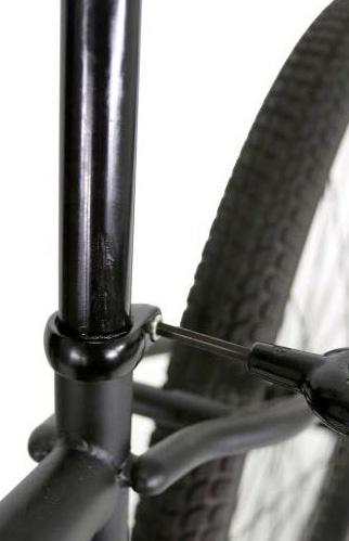 seatpost. Tighten anywhere on the seatpost that is of uniform diameter.
