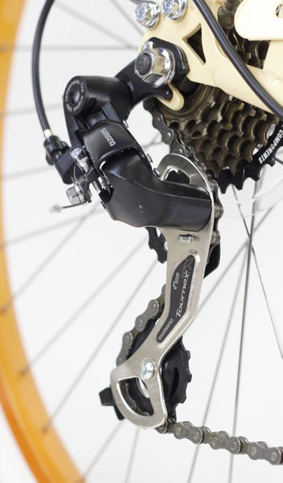 Rotate pedals until the chain falls into the smallest cog.