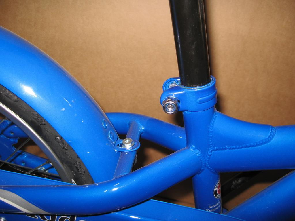 Insert left pedal into left crankarm and turn counterclockwise. 6. INSTALL SADDLE AND ADJUST SADDLE HEIGHT.