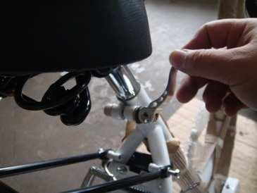 Choose a pedal and start threading into the corresponding crank arm by hand turning the pedal axle toward the front of