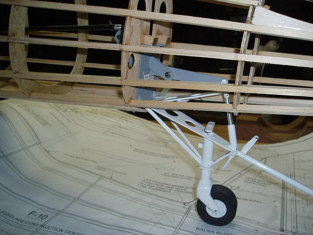 Jensen design. Earl provided me photos of the folding wing mechanism and tail wheel he provides for that model.
