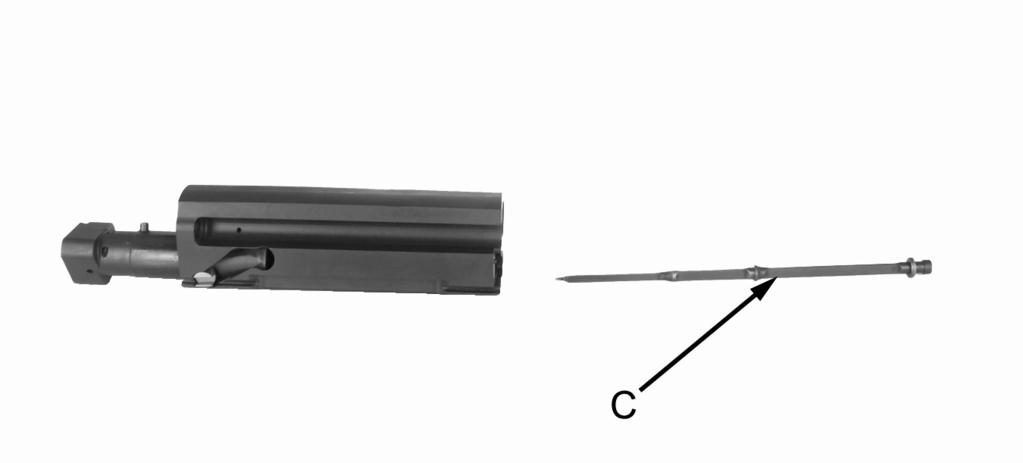 Push in on detent (B) and rotate firing pin