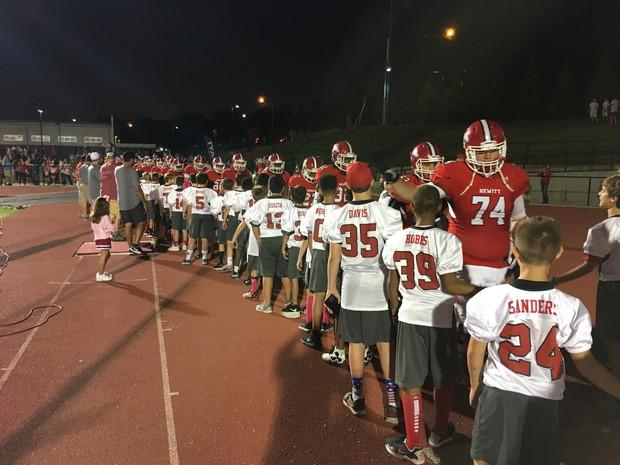 "Head Coach Josh Floyd said, ""It was great experience for all of our youth football players to experience Friday night lights."