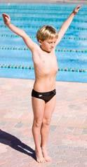 Standing Dive from Springboard Fig. 8-14A Extend your arms overhead with your upper arms pressing against your ears.