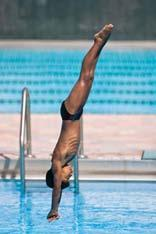 One-part takeoff with forward dive tuck from the springboard With your toes on the end of the board, repeat the forward dive tuck on the springboard using a one-part takeoff.